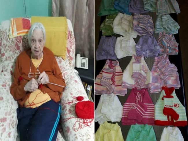 Idosa aniversariante costura casaquinhos e meias de lã para bebês carentes